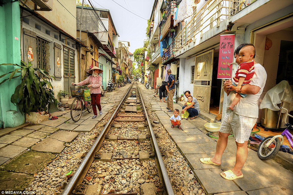A really tight Railway line: market traders have to move out and even dismantle their shop displays when the train is approaching